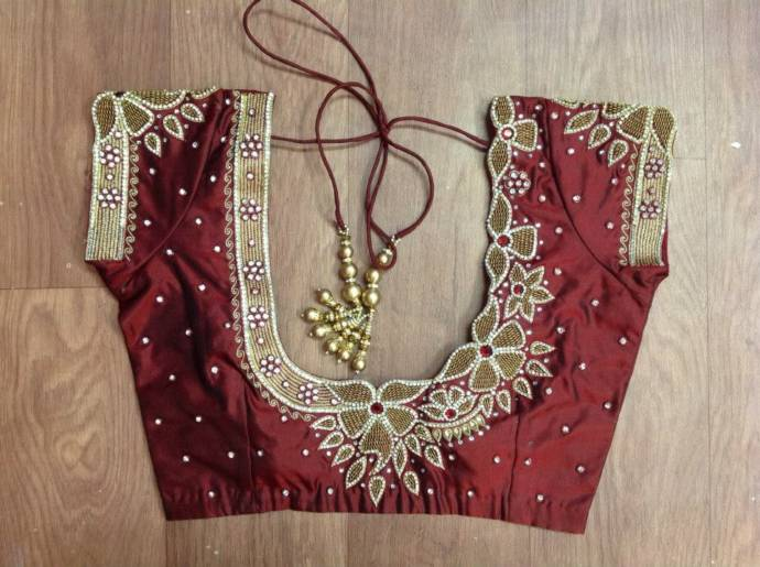 Back heavy work Blouse design with bead