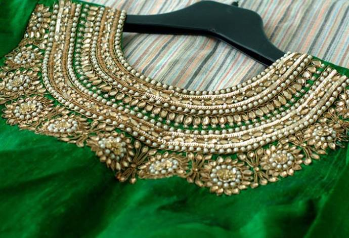 Green heavy neck work zardousi blouse design
