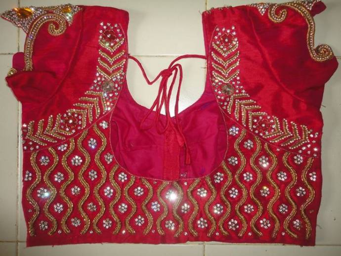 Hand work on zardousi blouse design
