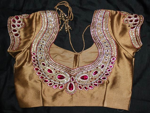 Heavy work on back zardousi blouse design