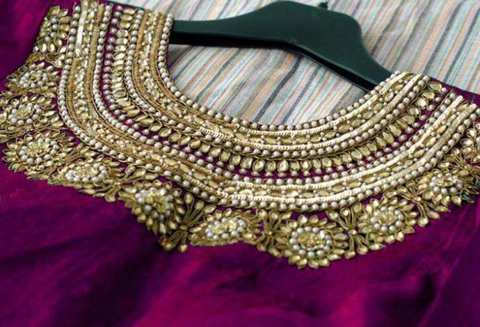 Purple round work on zardousi blouse design
