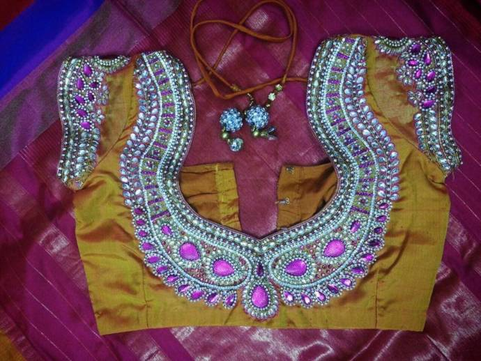 Latest new trend with back neck blouse designs with beads for saree.