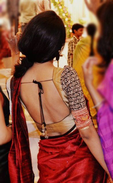 Backless blouse design with beads