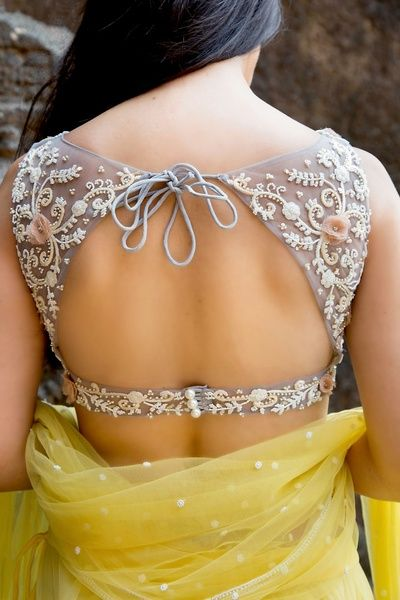 Backless blouse with narrow waist strap and laces
