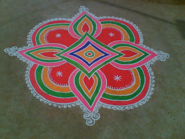 Big and bright rangoli pattern with red base