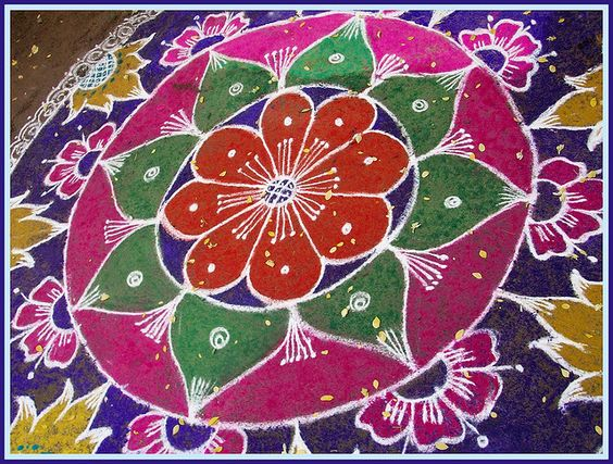Big rangoli with floral pattern in layers