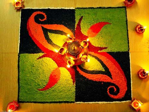 Bright and Colorful rangoli design in black and green base