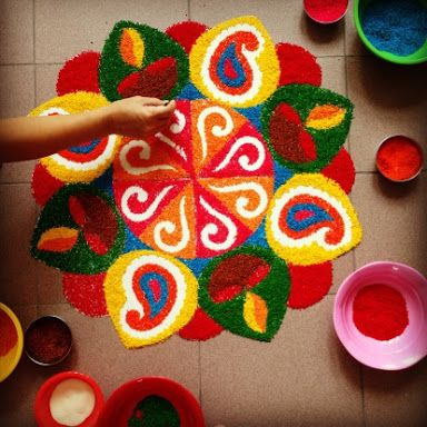 Colorful rangoli design with diyas