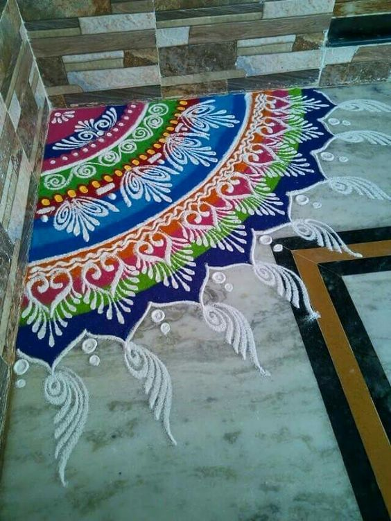 Corner rangoli with colorful shades and designs