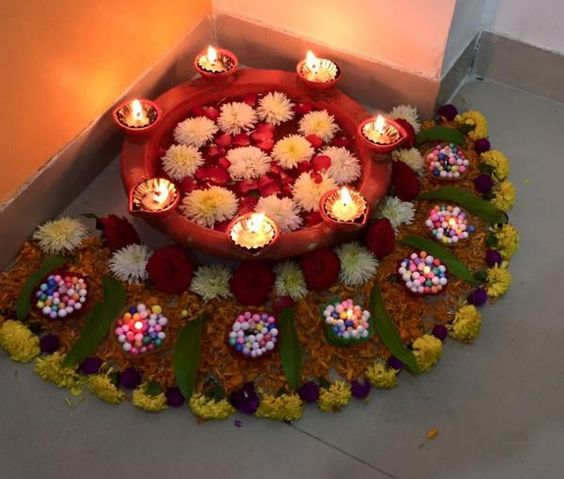 Corner rangoli with flowers