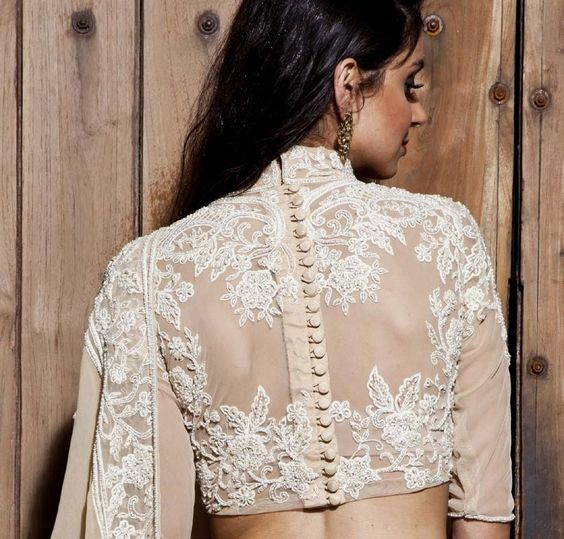 Embroidered mid-sleeve high neck blouse with potli buttons