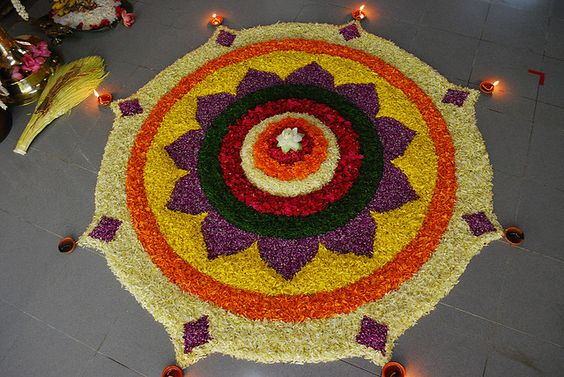 Colourful floral rangoli design with petals