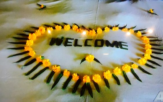 Floral rangoli with yellow marigold and leaves