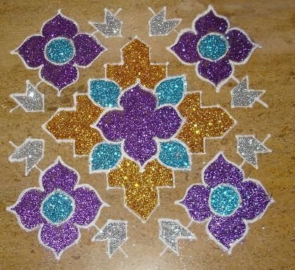 Glitter Rangoli design in golden, silver, purple and blue