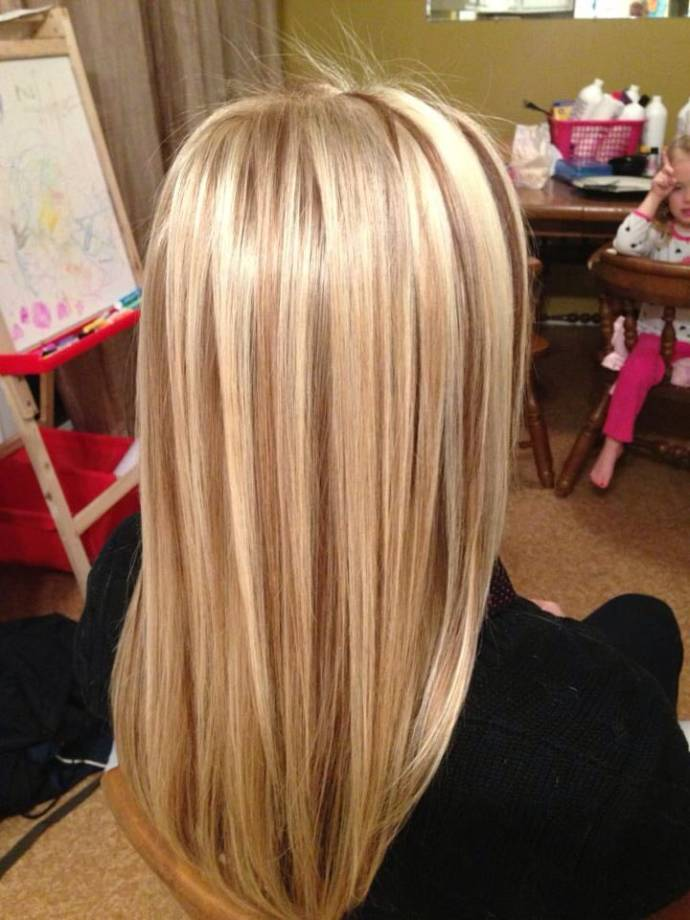 Golden blonde straight hair with low lights