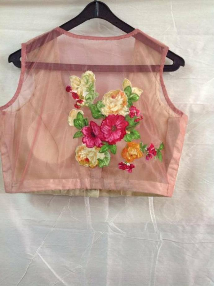 Net blouse with floral patch work