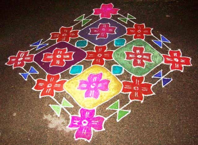 Rangoli Design surrounded by floral patterns