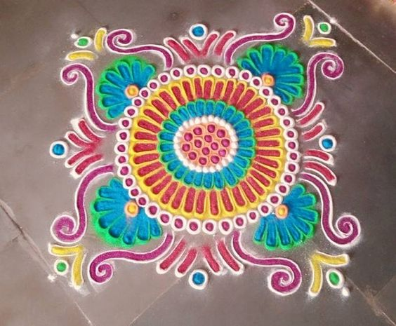 Rangoli colors filled between powdered outline