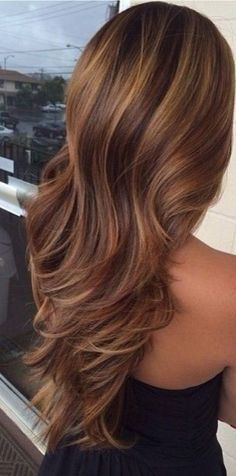 Wavy hair with golden highlights