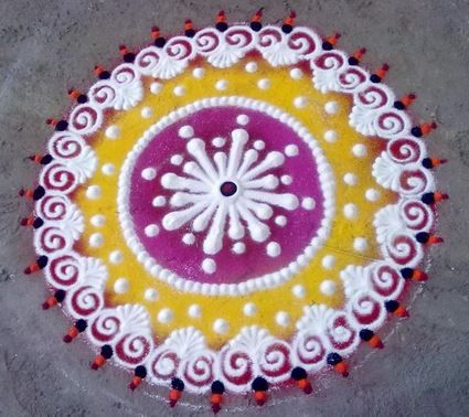 White dotted rangoli with designs