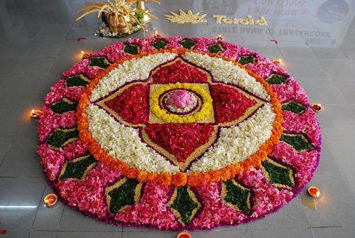 big petalled rangoli for diwali with diyas