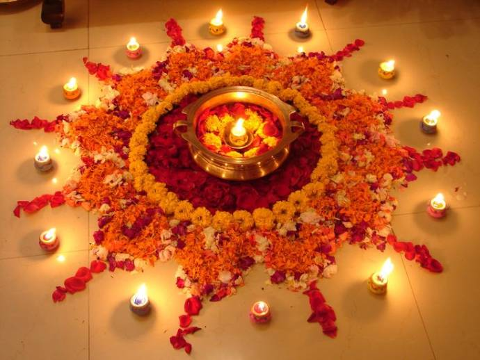 floral rangoli with diyas for diwali