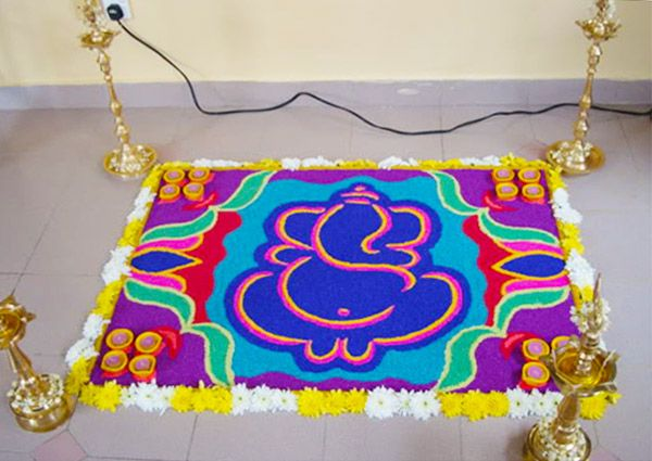 ganapati rangoli with floral patterns
