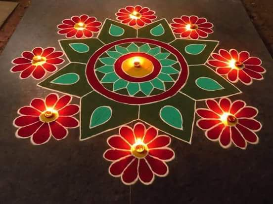 golden and orange petaled rangoli