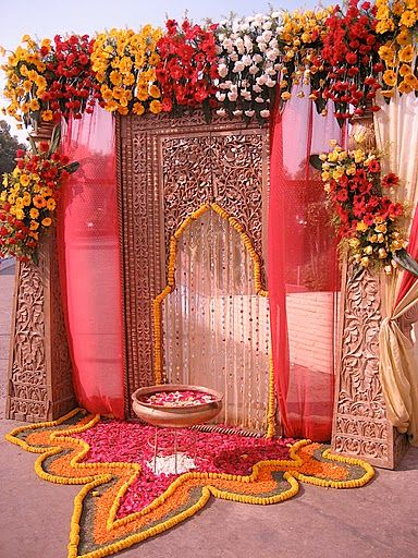 floral rangoli design with petals for wedding