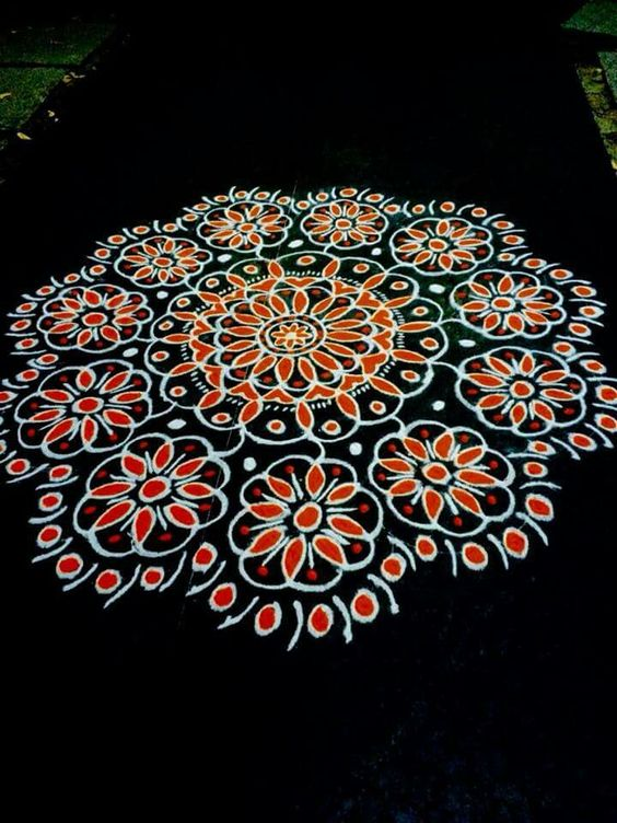 Big dotted rangoli with floral patterns in red and white