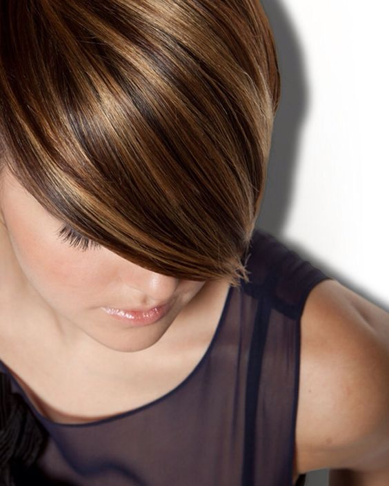 Caramel highlights on brunette hairs
