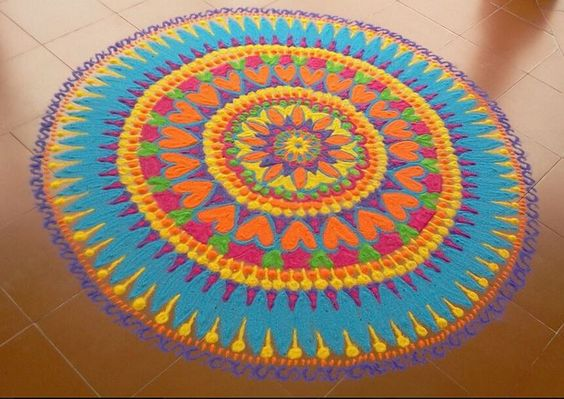 Circular rangoli with rich colors and designs