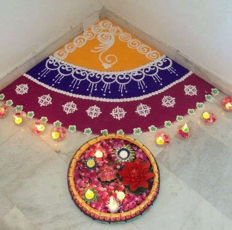 Corner rangoli with three colors