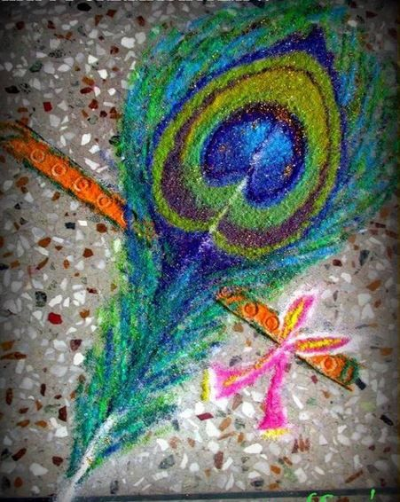 Flute and peacock feather rangoli