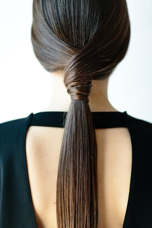 Sleek knotted hairstyle