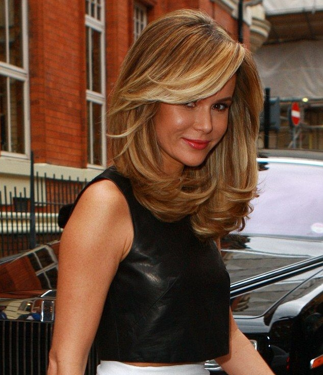 Voluptuous hairstyle with side swept long fringes and highlights