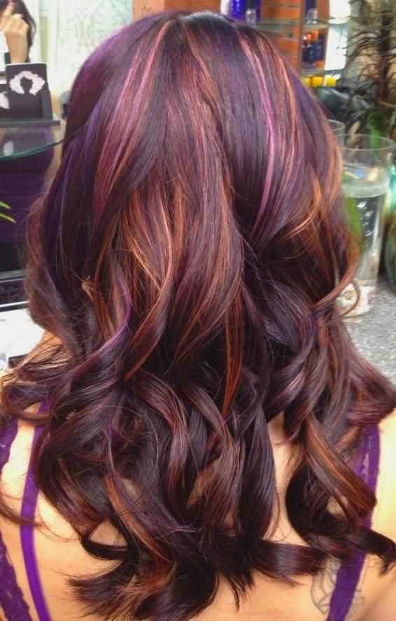 Wavy hair with plum highlights