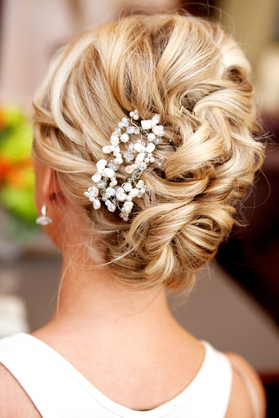 Messy french side bun with hair accessory