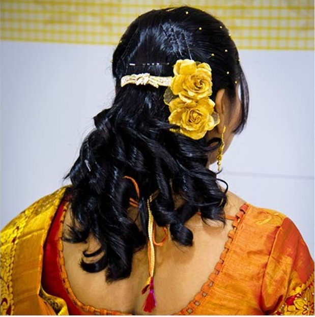 Intricately curled semi-open hairstyle