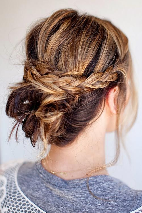 A messy bun with double braids