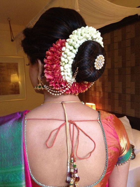 Bun with multiple floral gajra and net