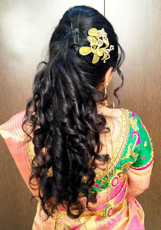 Half up half open curly hairstyle for wedding