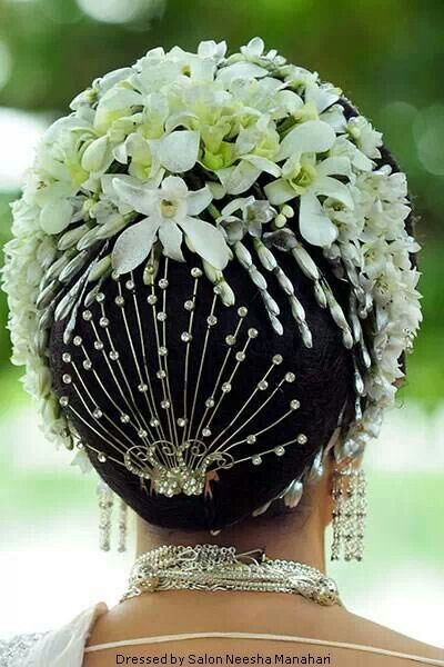 Heavy bun with floral decorations and accessories