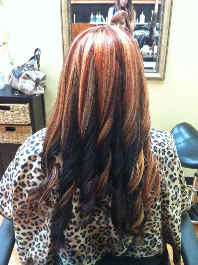 Red and blonde highlights curled into dark brown