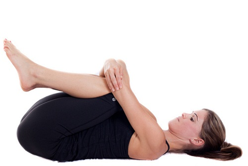Wind relieving pose (Pavan muktasana)