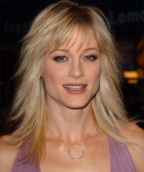 Blonde bangs layered medium hairstyle