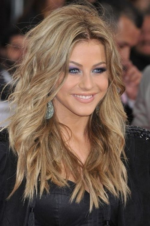 Glam game blonde layered feather hairstyle