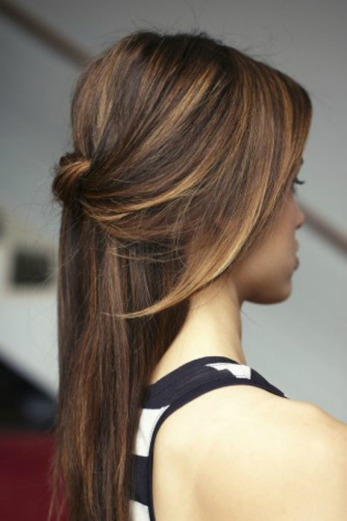 One side pinned back semi open hairstyle