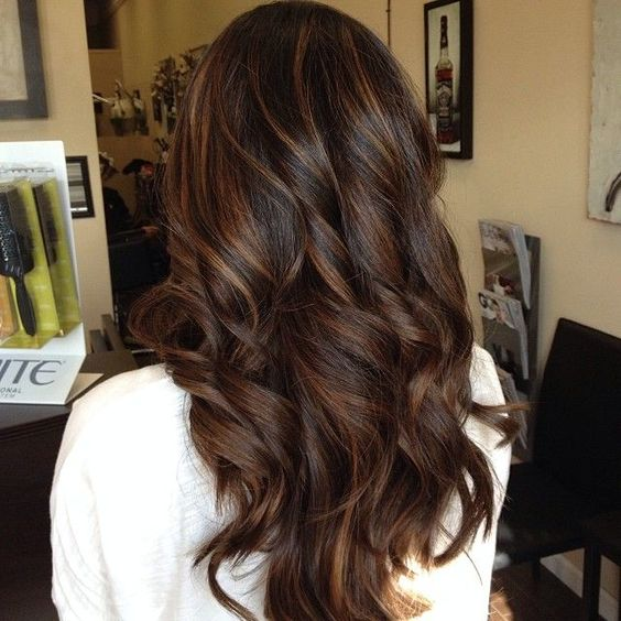 Open curly hairstyle with highlights