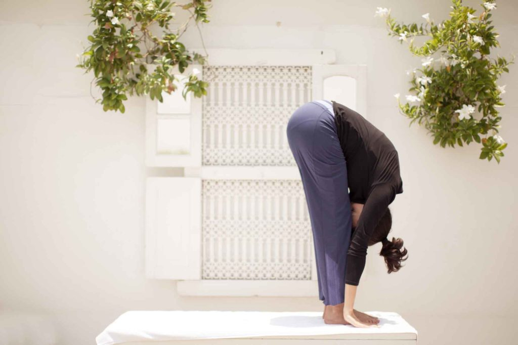Padahastasana or the Standing Forward Bend
